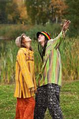 Young rastafarian people in autumn park
