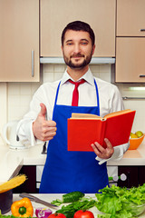 cook at the kitchen showing thumbs up