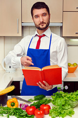 young man pointing at the cookbook