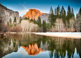 View of half dome reflected in the Merced river at Yosemite