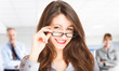 Beautiful woman holding her eyeglasses