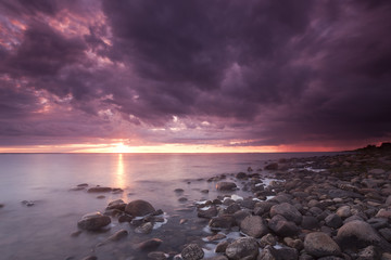 Beautiful moody sunrise with stormclouds, southern of Sweden