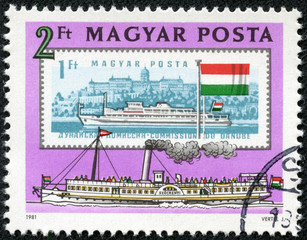 old and new stamps of boats on the Danube River in Budapest