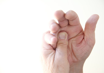 man with pain at base of fingers