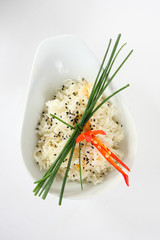 rice with chives and chili in a bowl