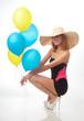 Beautiful woman with balloons