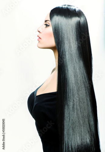 Beauty Girl with Long Straight Black Healthy Hair.