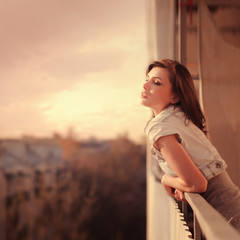 beautiful young woman enjoying the freshness of the morning
