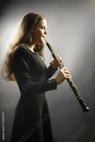 Classical musician oboe musical instrument playing.
