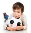 Little boy playing soccer ball