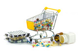 shopping cart full of pills isolated on white. Shopping cart wit