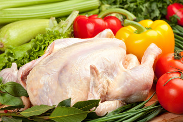 Fresh raw chicken and vegetables