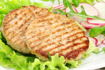 Grilled rabbit burgers with lettuce and radish salad