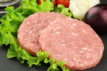 Raw rabbit burgers with lettuce
