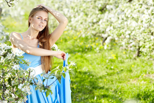beautiful blonde in a spring garden
