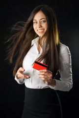 Woman holding red credit card