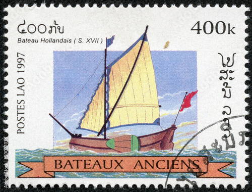 stamp printed in Laos shows image of a sailing ship