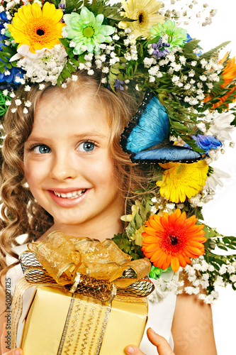 Child with gift box and flower.