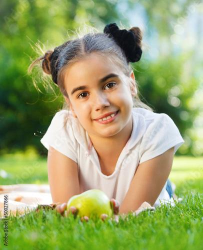 Smiling brunette little girl in summer day