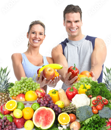 Happy couple with fruits.