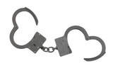 Black old metallic handcuffs isolated on white background