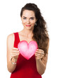 Beautiful young woman holding red love heart.