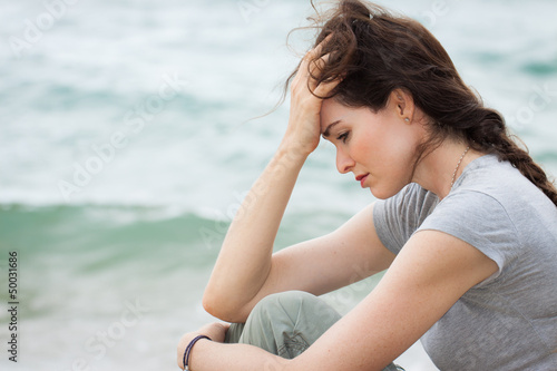 Sad and upset woman deep in thought - 50031686