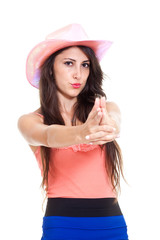 Brunette longhaired woman shooting with fingers.