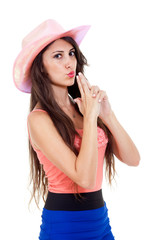 Beautiful brunette longhaired woman with pink cowboy hat.
