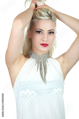 Beautiful young woman with diamond necklace holding her hair up,
