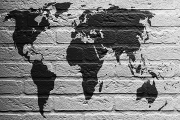 Brick wall with a painting of a flag, World Map