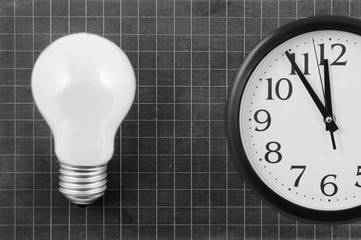 Lamp on blank school board and clock