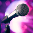 microphone against purple disco background