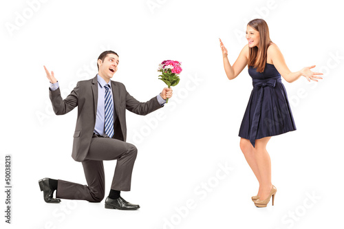 Young romantic man giving a bouquet of flowers to a woman