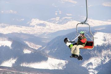 Snowboarder on a ski lift