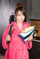 Woman frying eggs and bacon on an iron and hair straightener