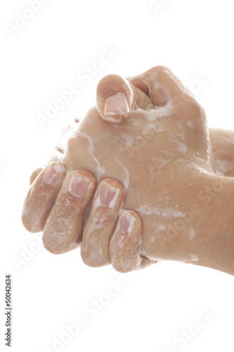 washing hand against white background