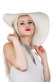 Beautiful young woman with diamond necklace and a hat, isolated