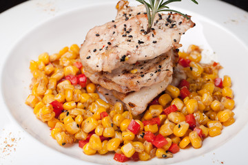 closeup of fried meat and corn