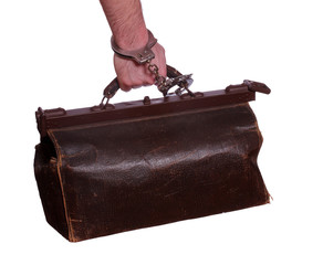 old leather bag with handcuff