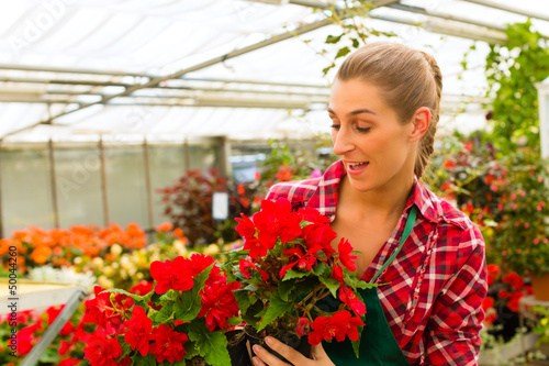 gardener in her green house flower shop