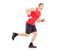 Full length portrait of a fit muscular male athlete running