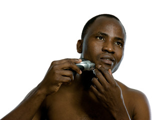 An african-american man shaving, isolated on white background