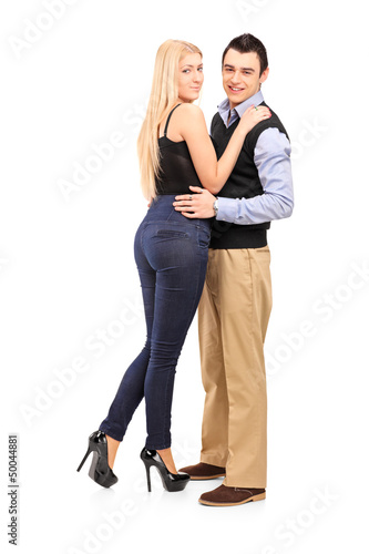 Full length portrait of a young man and woman in an embrace