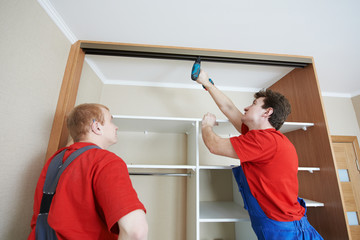 Wardrobe joiners at installation work