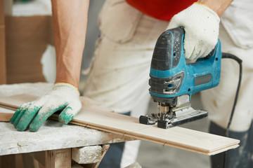 Cutting parquet board with jigsaw