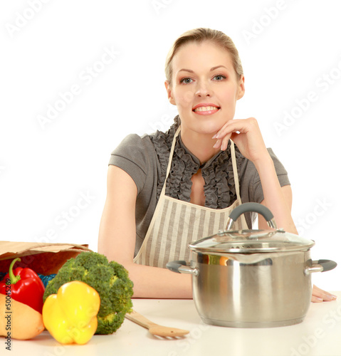 Woman in apron with grocery bag , isolated on white background