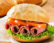 Sandwich roll with salami and salad