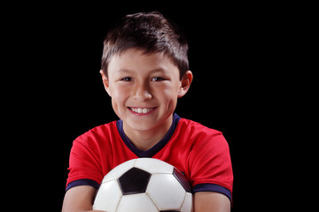 Boy with soccerball on black backgound