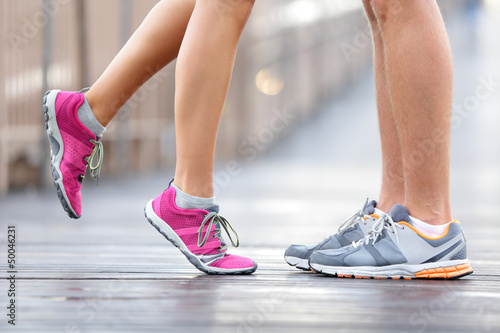 Leinwanddruck Bild Love sport concept - running couple kissing